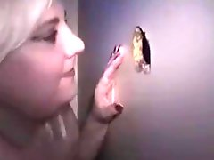 Two Mature Sluts Sucking And Playing At The Gloryhole
