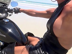 Sexy Leather Biker In Thigh Boots On The Beach