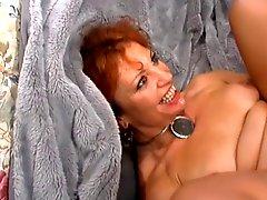 Mature Redhead Enjoys Young Cock