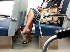 Mature Ebony Dangling Bare Leg